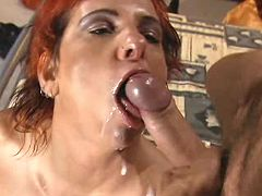 Ardent redhead milf fucking and catching facial