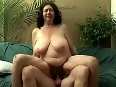 Large busty grandma jumping on cock