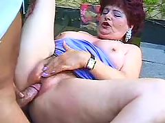 Horny plump mature relaxes on table