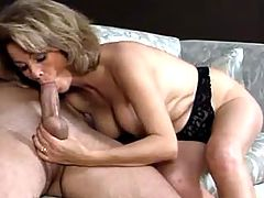 Lustful busty mature makes blowjob