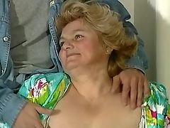 Guy dildoing fat aged lady on table