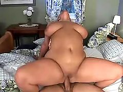 Beautiful fatty gets cum on massive boobs