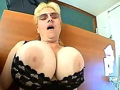 Chubby milf with huge tits fucks on desk